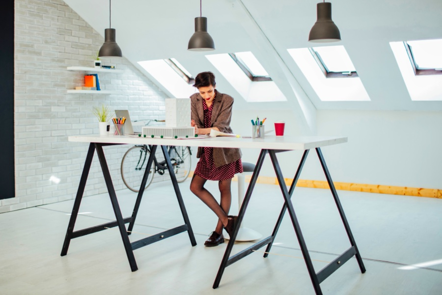female architect working at a stand up desk